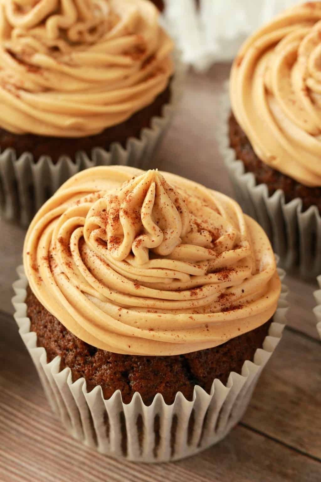 Vegan coffee cupcakes topped with coffee buttercream and cinnamon.