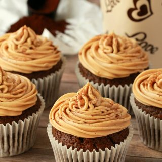 Vegan coffee cupcakes on a wooden board.