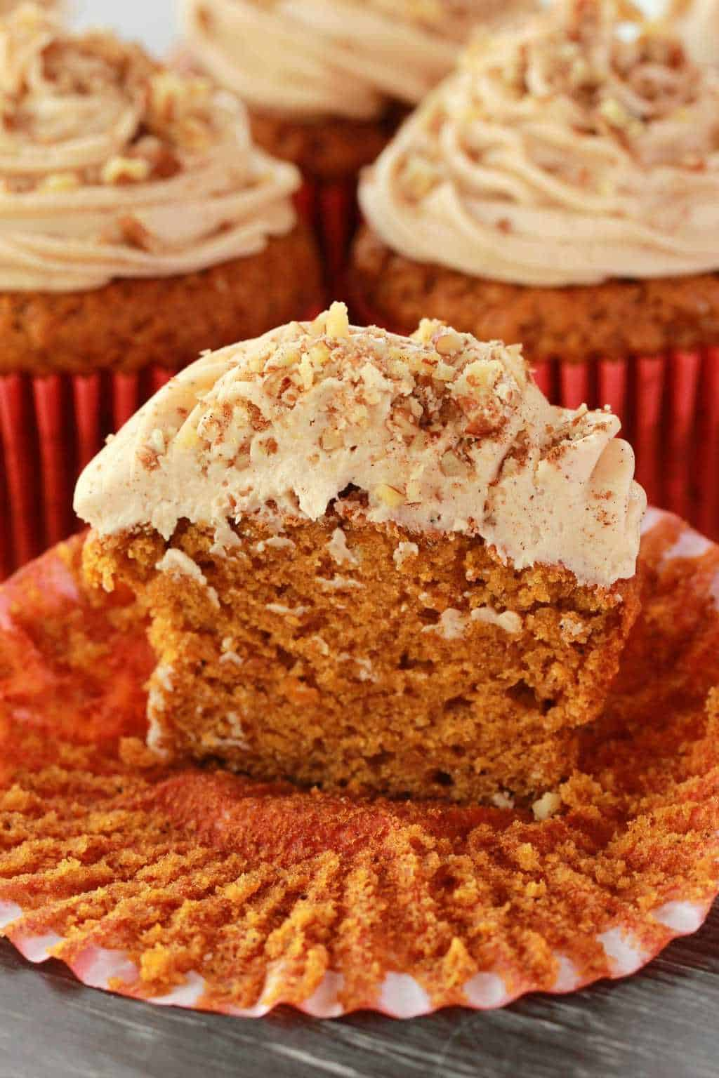 Vegan pumpkin cupcake cut in half to show the texture.