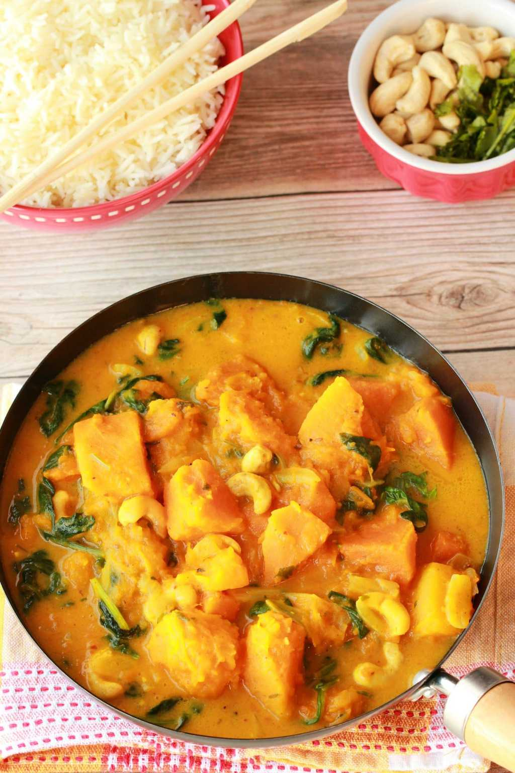 Thai inspired pumpkin curry! This easy 10-ingredient recipe (including the rice!) is ready in less than 45 minutes and makes a fabulously delicious dinner. #vegan #lovingitvegan #vegandinner #entree #glutenfree