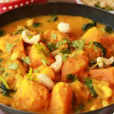 Vegan pumpkin curry topped with cashew nuts