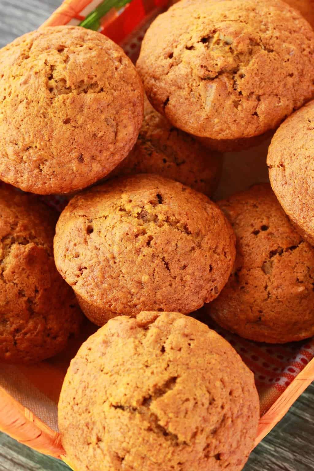 Vegan pumpkin muffins in a woven basket.