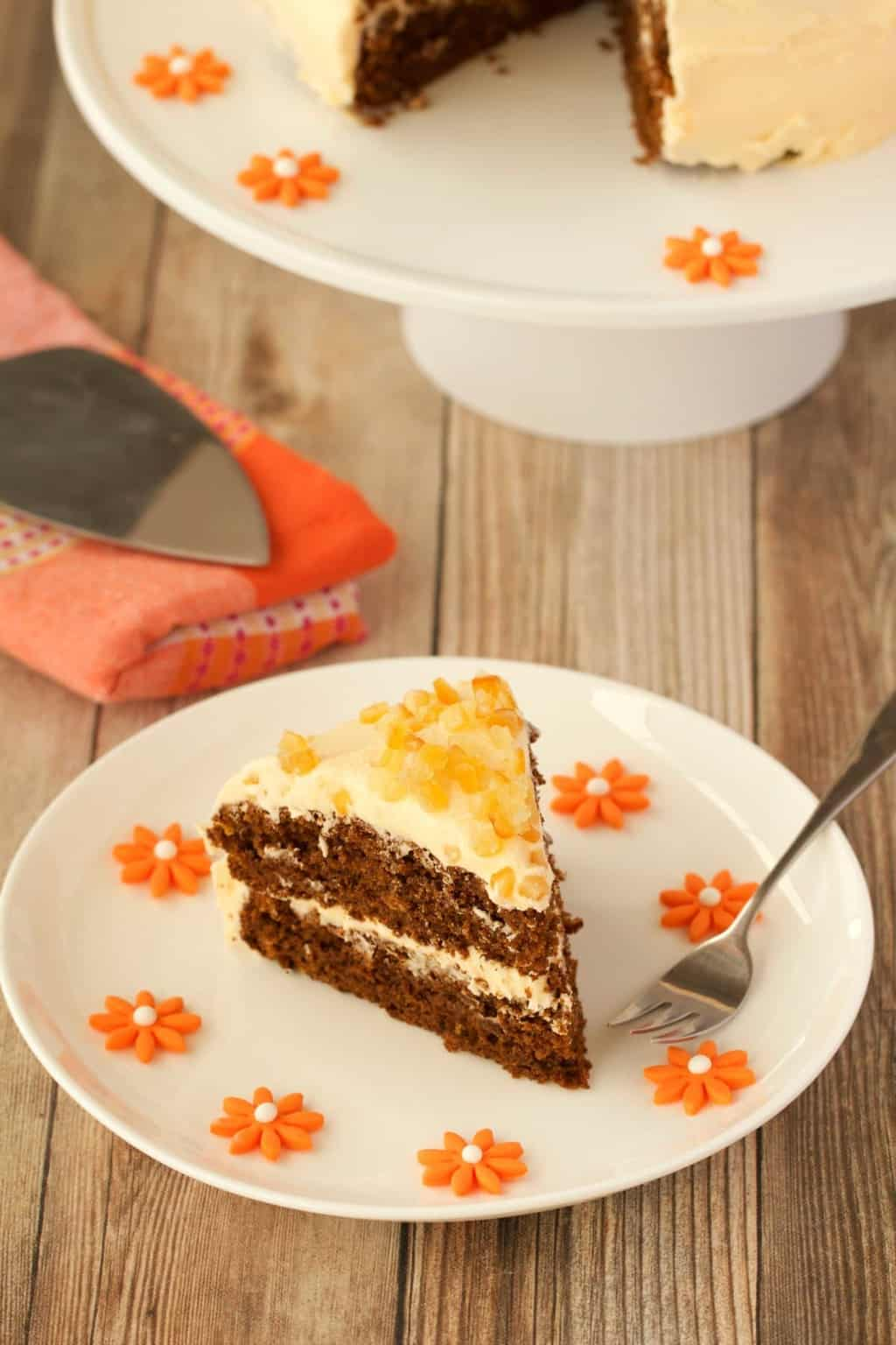 Perfectly flavored gingerbread cake with orange frosting. This gorgeous vegan cake is rich, moist and packed with gingerbread flavor! #vegan #lovingitvegan #gingerbread #vegancake #dessert #dairyfree