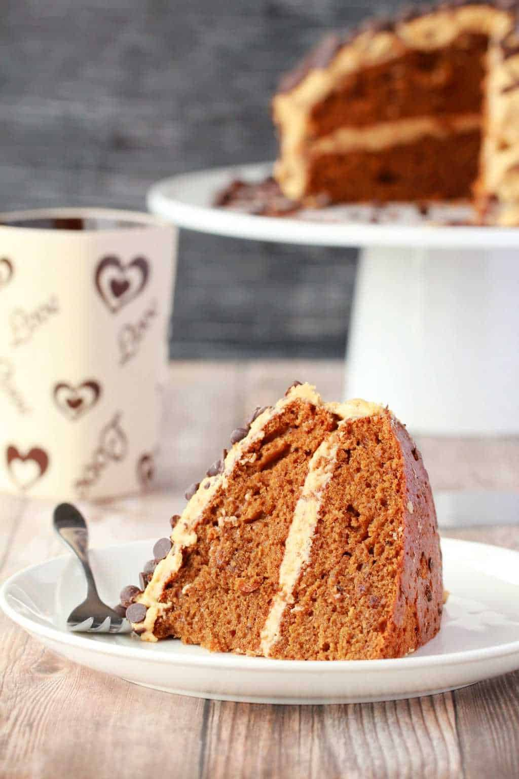 Insanely delicious vegan coffee cake with kahlua frosting. This isn't just a cake to eat with your coffee, this is fabulously decadent coffee flavored cake! #vegan #lovingitvegan #coffeecake #vegancake #dairyfree #kahluafrosting
