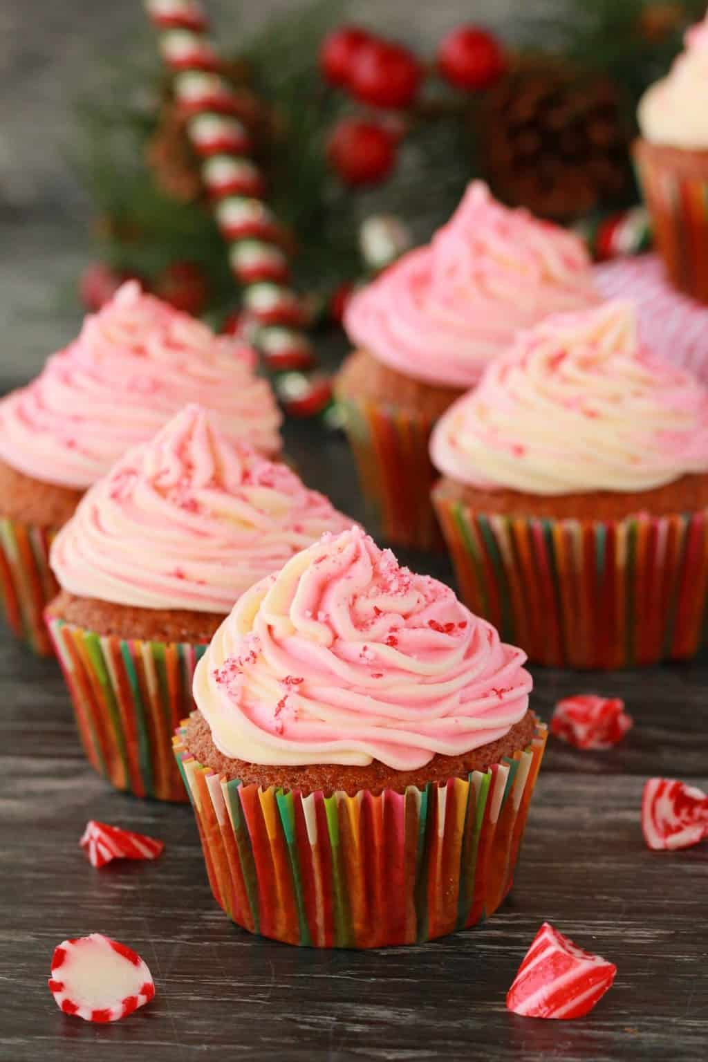 Gorgeous vegan peppermint cupcakes with a pink swirl peppermint frosting! These vegan cupcakes are  moist, spongey and sooo pretty. Loaded with peppermint flavor, this is a winner for anyone who loves peppermint, and cupcakes! #vegan #cupcakes #lovingitvegan #vegancupcakes #vegandessert #dairyfree | lovingitvegan.com