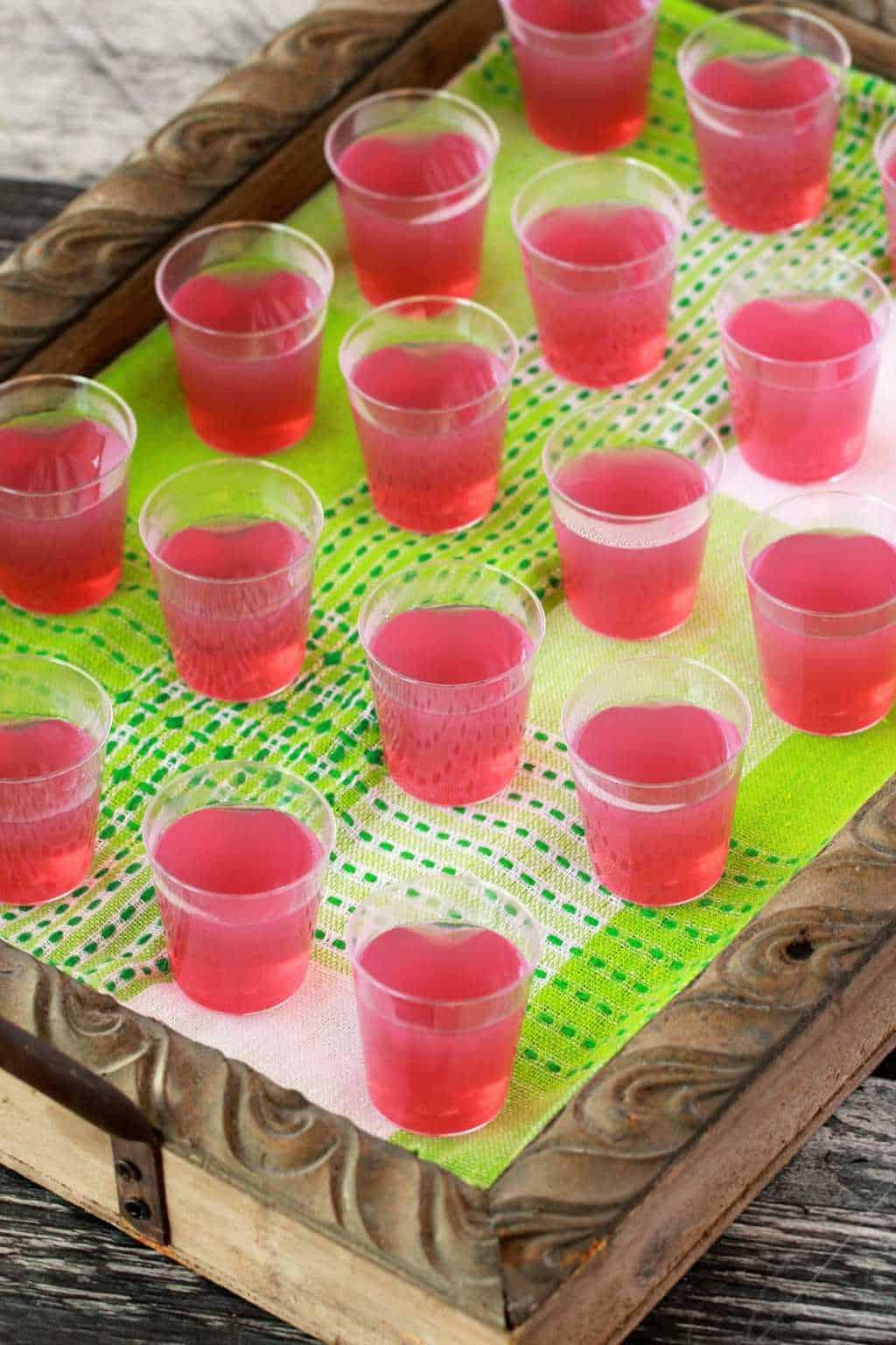 These festive boozy vegan jello shots are perfect for parties! They're colorful, fun and super easy to make! Top with vegan whipped cream! #vegan #lovingitvegan #jelloshots #drinks #glutenfree #dairyfree   lovingitvegan.com