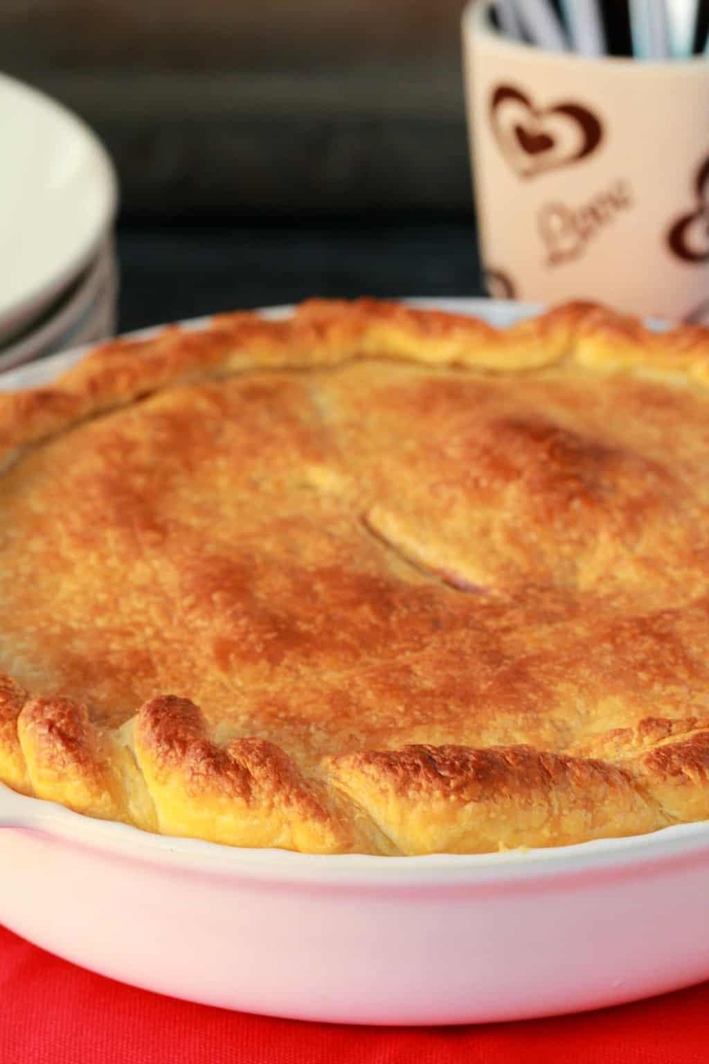 Vegan pot pie in a white pie dish.