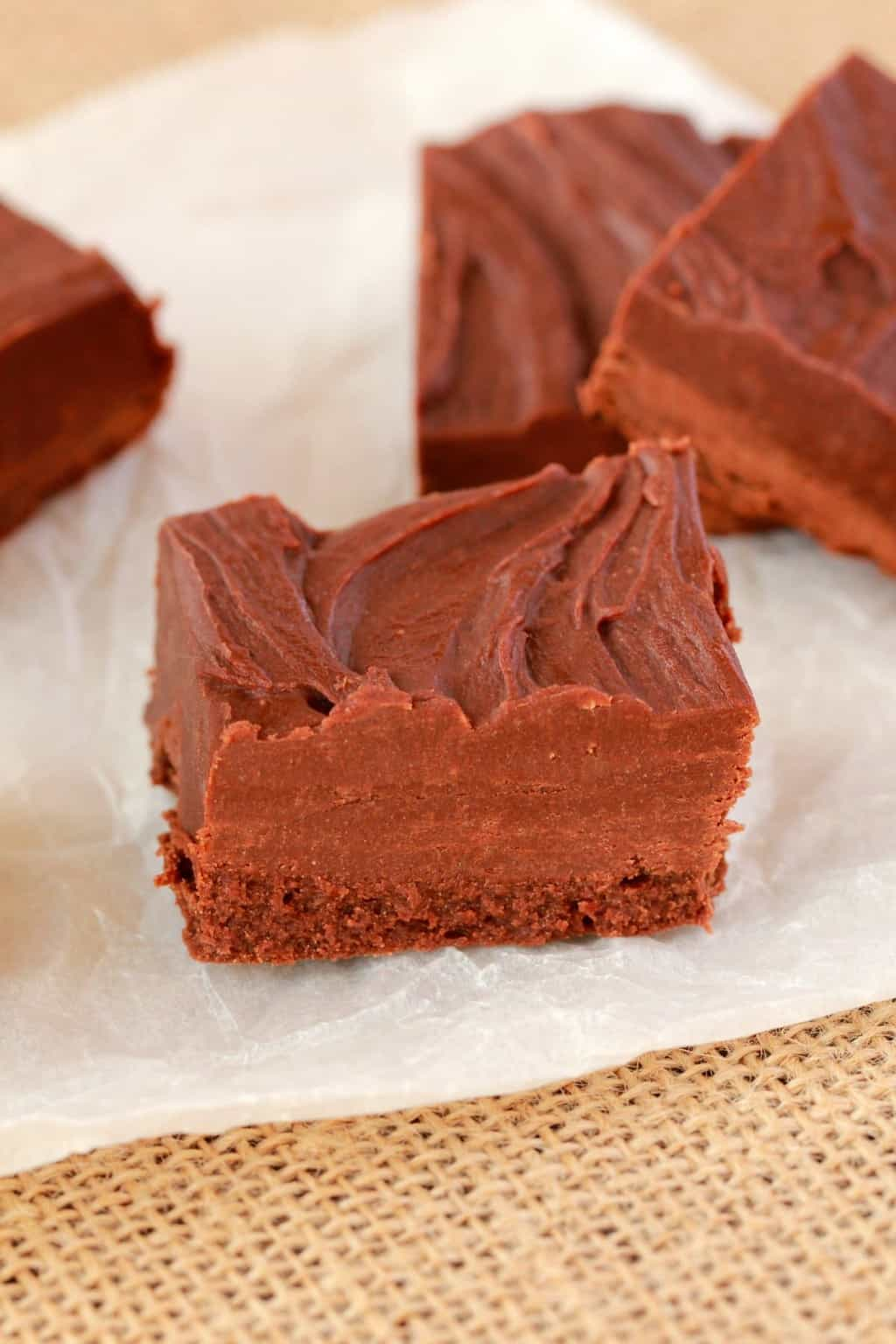 Microwave chocolate fudge on parchment paper.