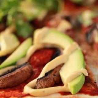 Sliced vegan mushroom pizza