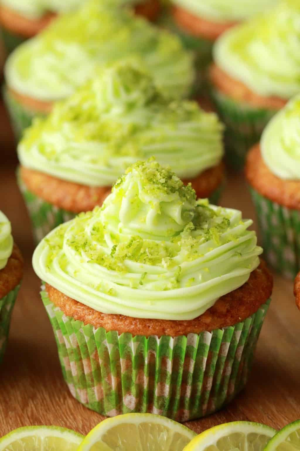 Vegan Key Lime Cupcakes on a wooden board