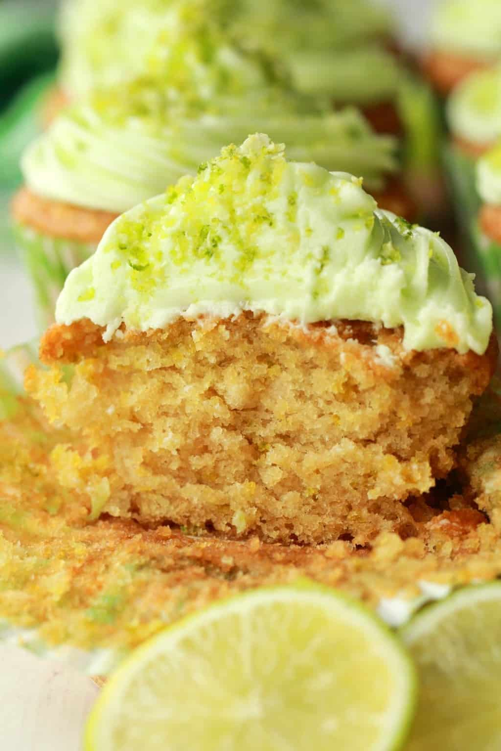 close up of vegan key lime cupcake sliced in half
