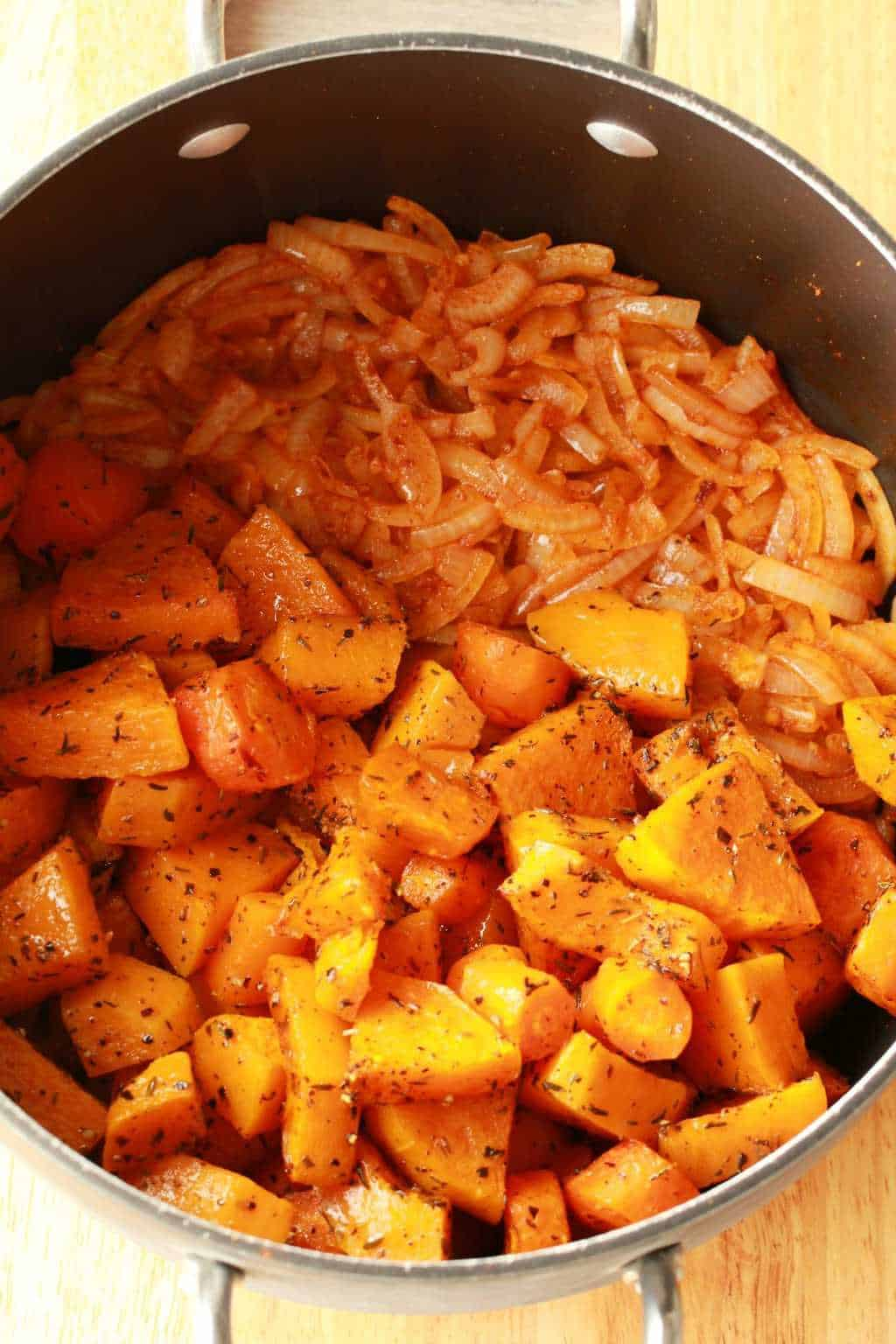 Roasted Butternut and Carrots in a pot with sautéed onions