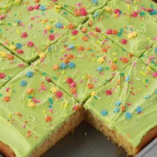 Vegan vanilla sheet cake cut into squares.