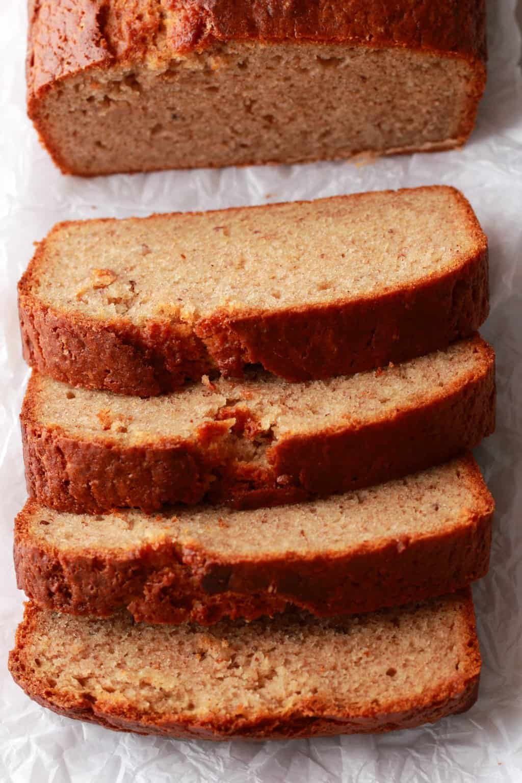 Sliced Vegan Banana Bread on parchment paper.