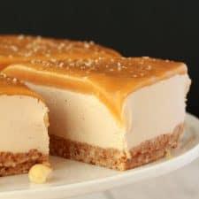 Vegan Cheesecake on a white cake stand.