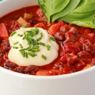 Vegan chili in a white bowl.