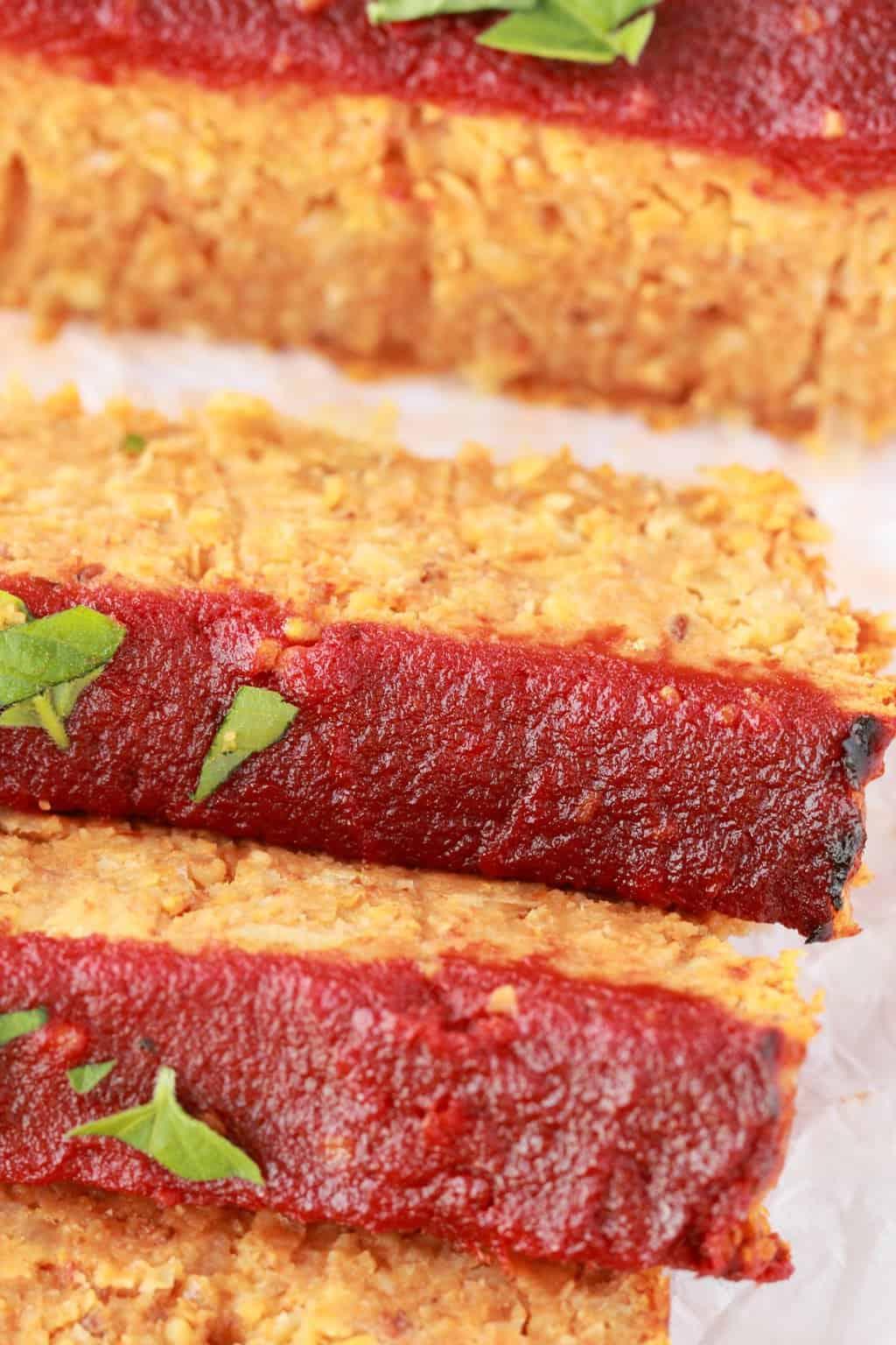 Sliced Vegan Meatloaf on parchment paper.