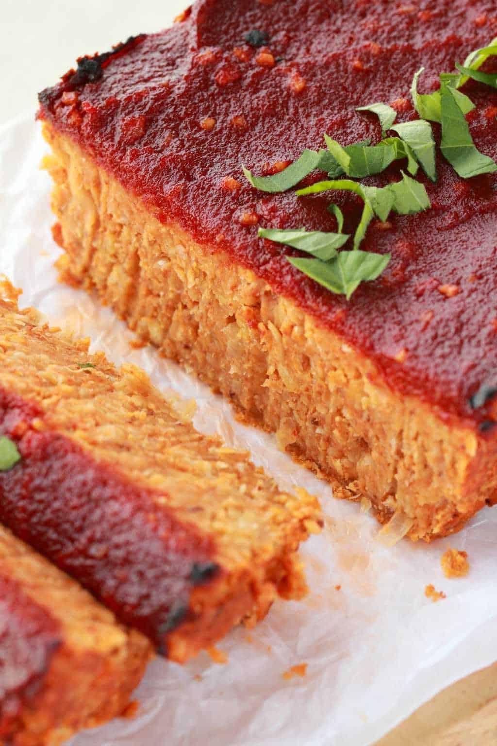 Vegan Meatloaf, sliced, on parchment paper.