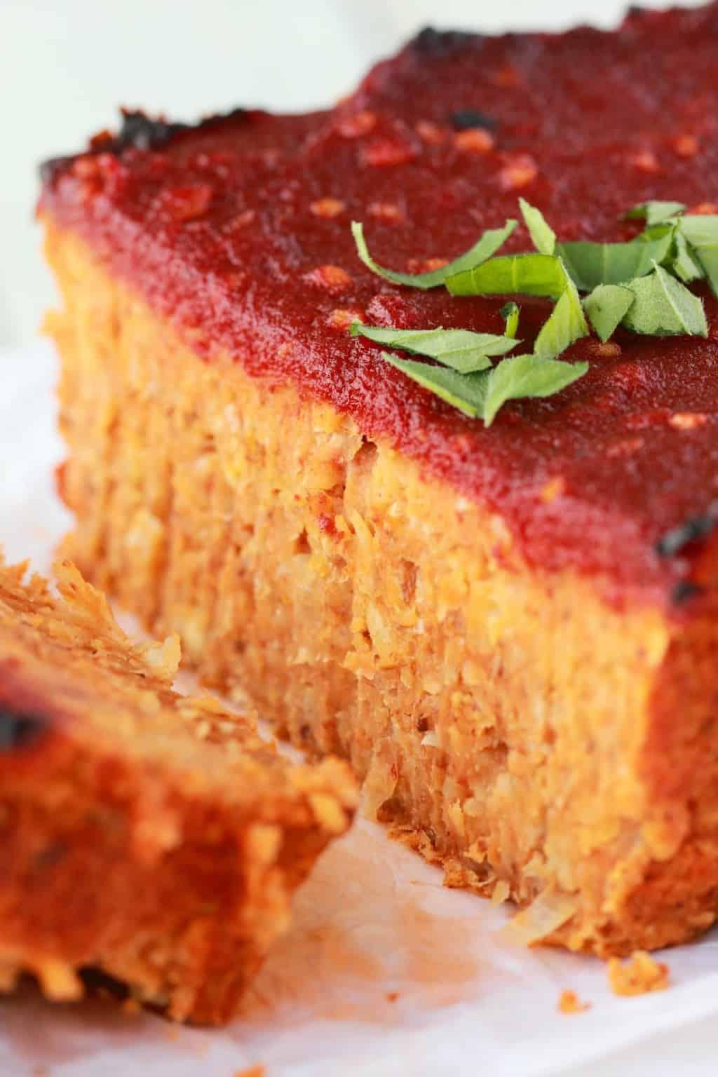 Vegan Meatloaf sliced. Fresh basil on top.