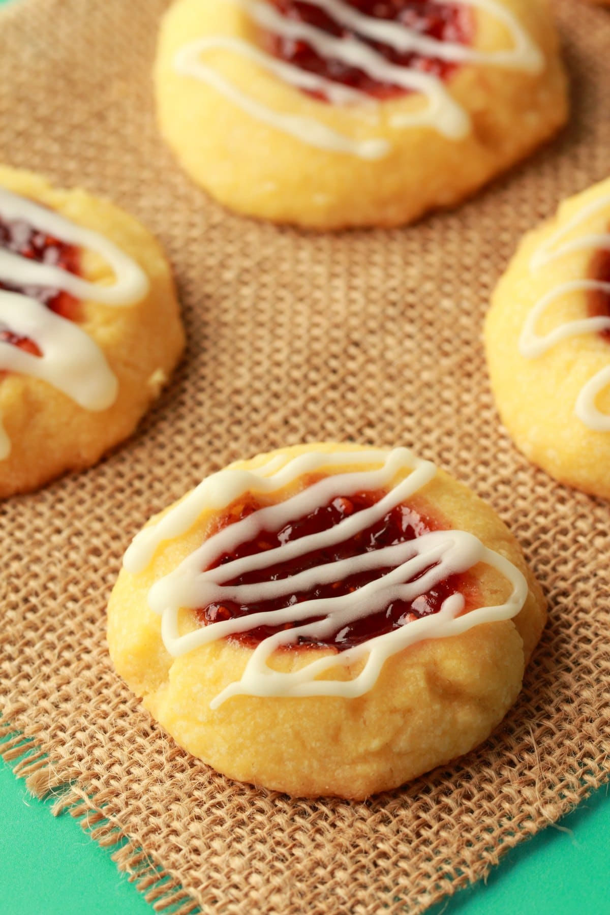 Vegan Thumbprint Cookies on a woven napkin.