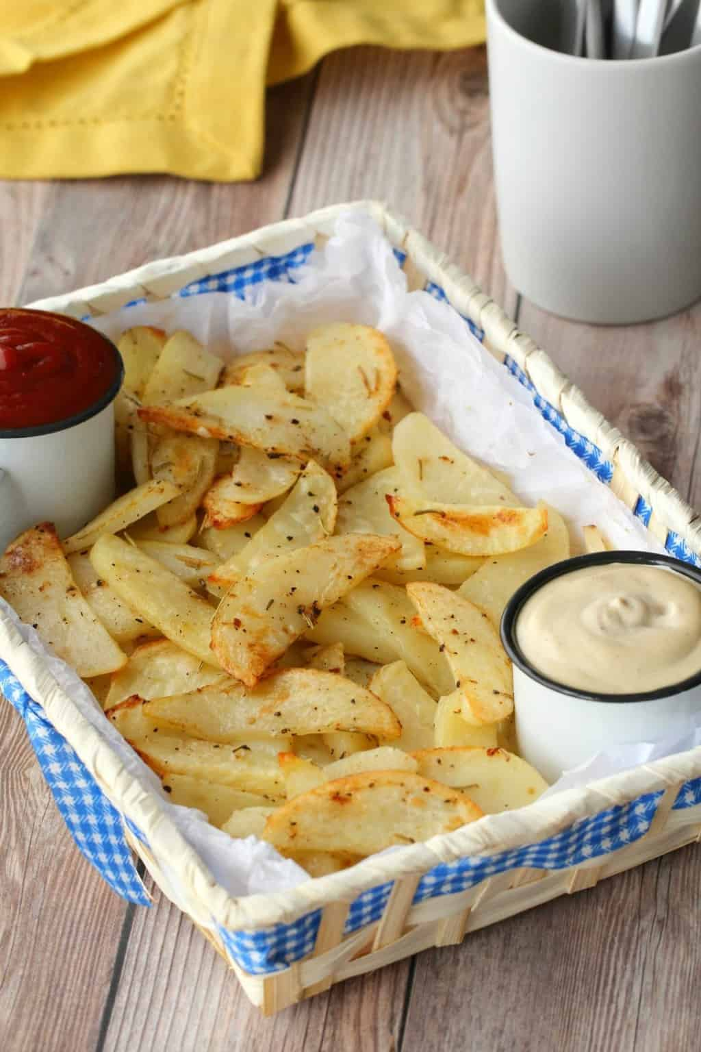 Baked Potato Fries in a basket with cashew sour cream and ketchup.