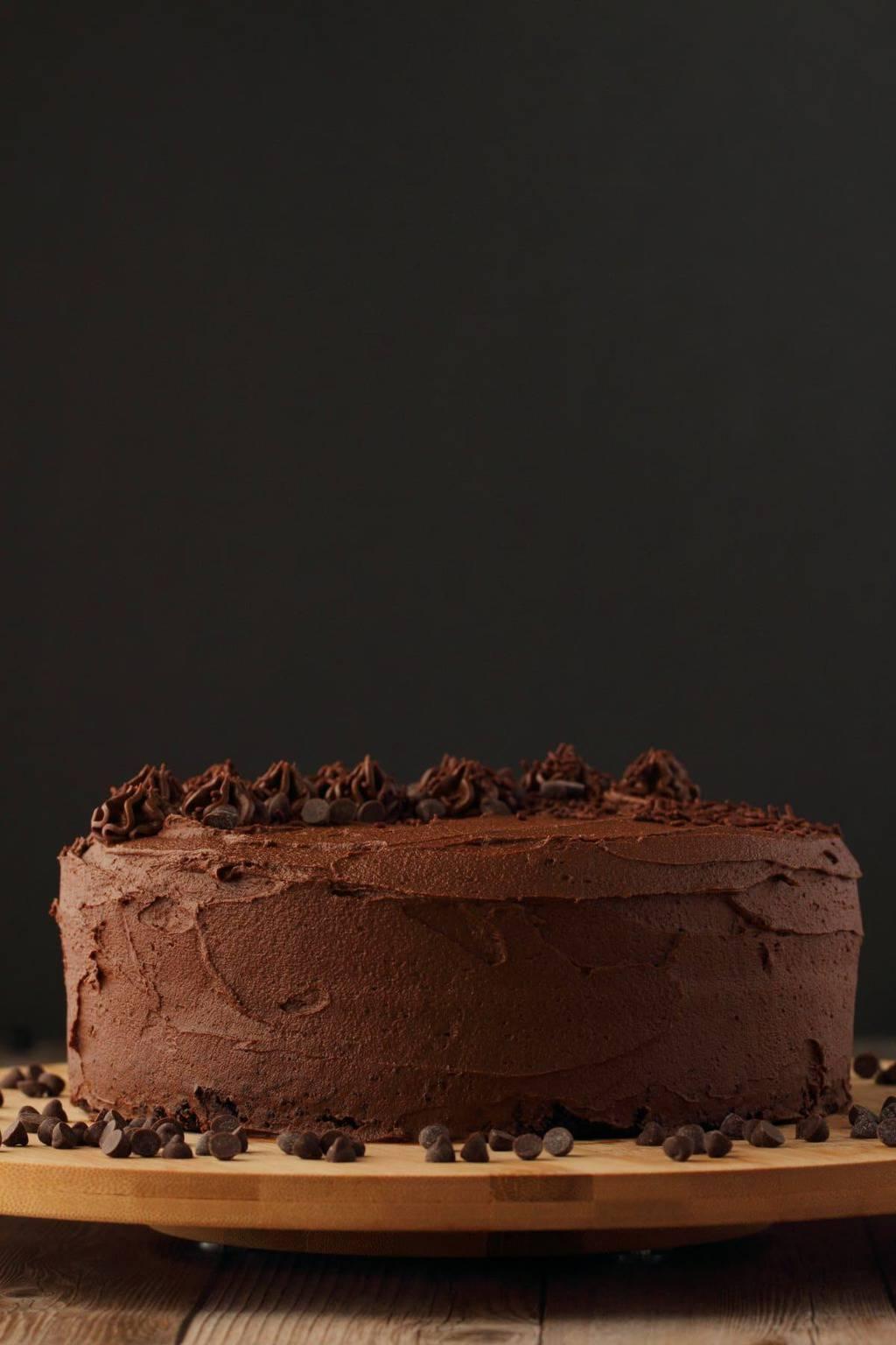Vegan Chocolate Zucchini Cake on a wooden board.
