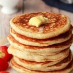Vegan pancakes in a stack with butter on top.