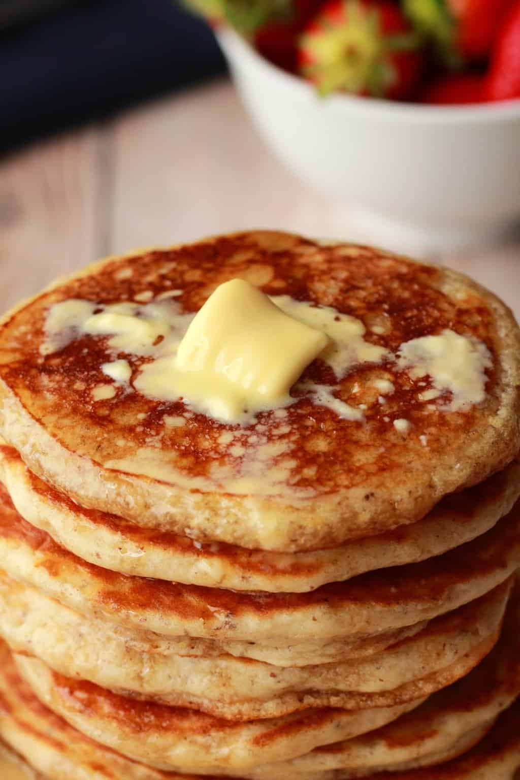 A stack of vegan pancakes with a pat of melting butter on top.
