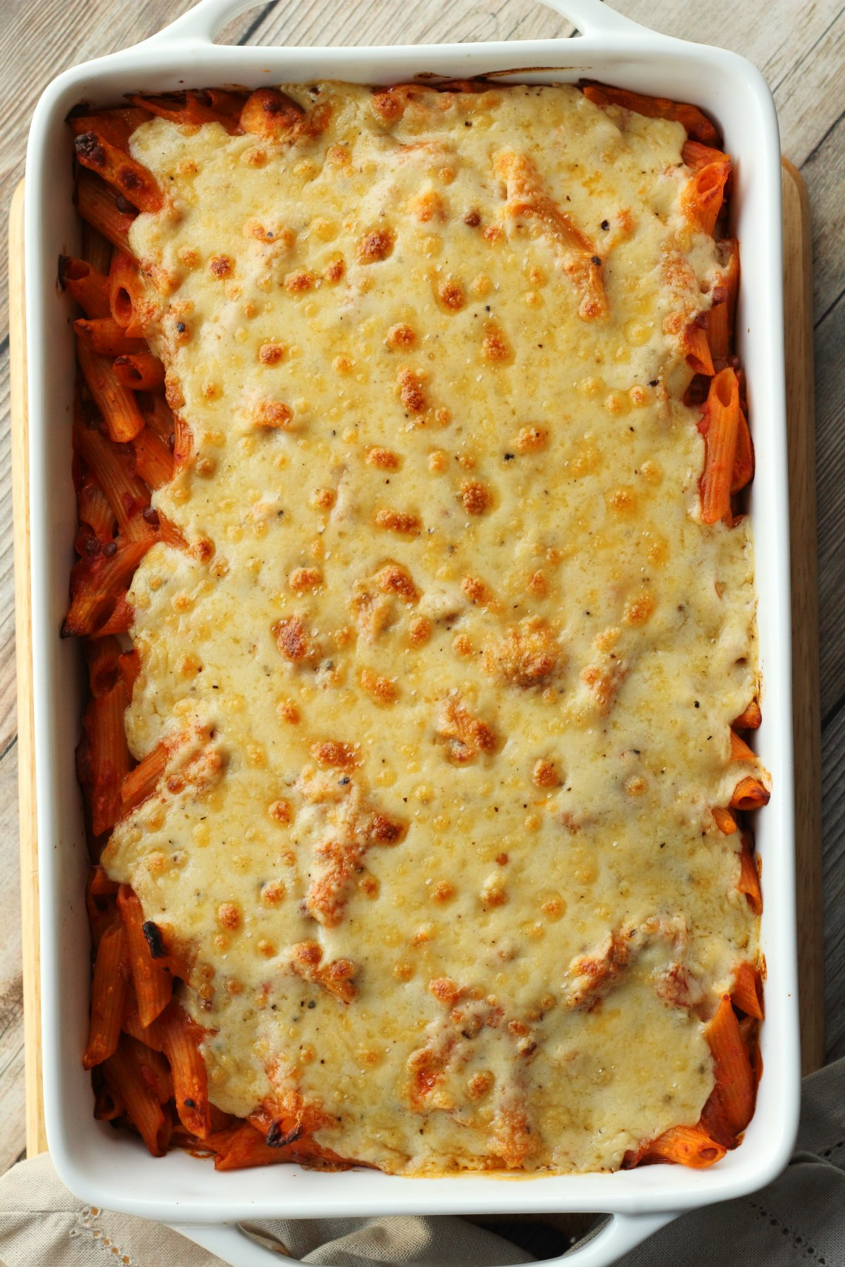 Vegan Pasta Bake straight out of the oven in a white oven dish.