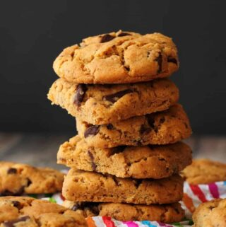 Vegan peanut butter chocolate chip cookies in a stack.