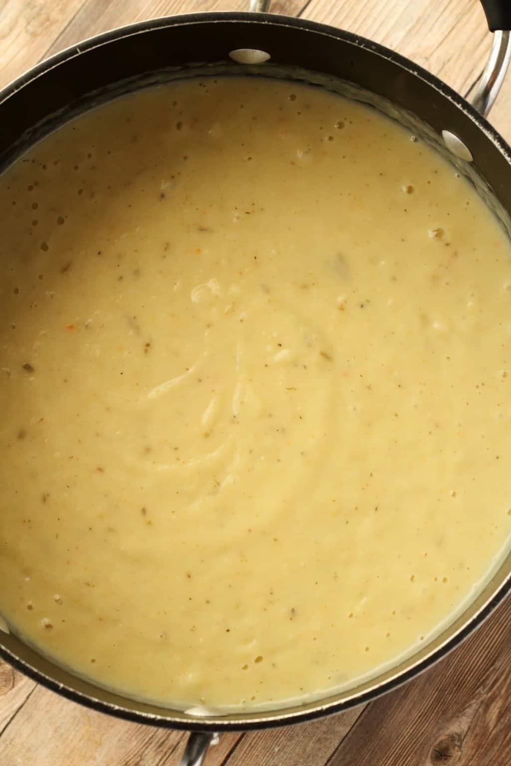 Vegan Potato Leek Soup freshly blended up in a pot.