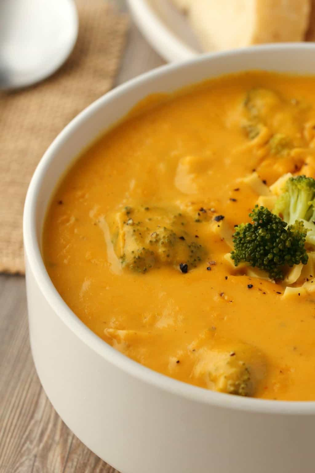 Vegan Broccoli Cheese Soup in a white bowl.