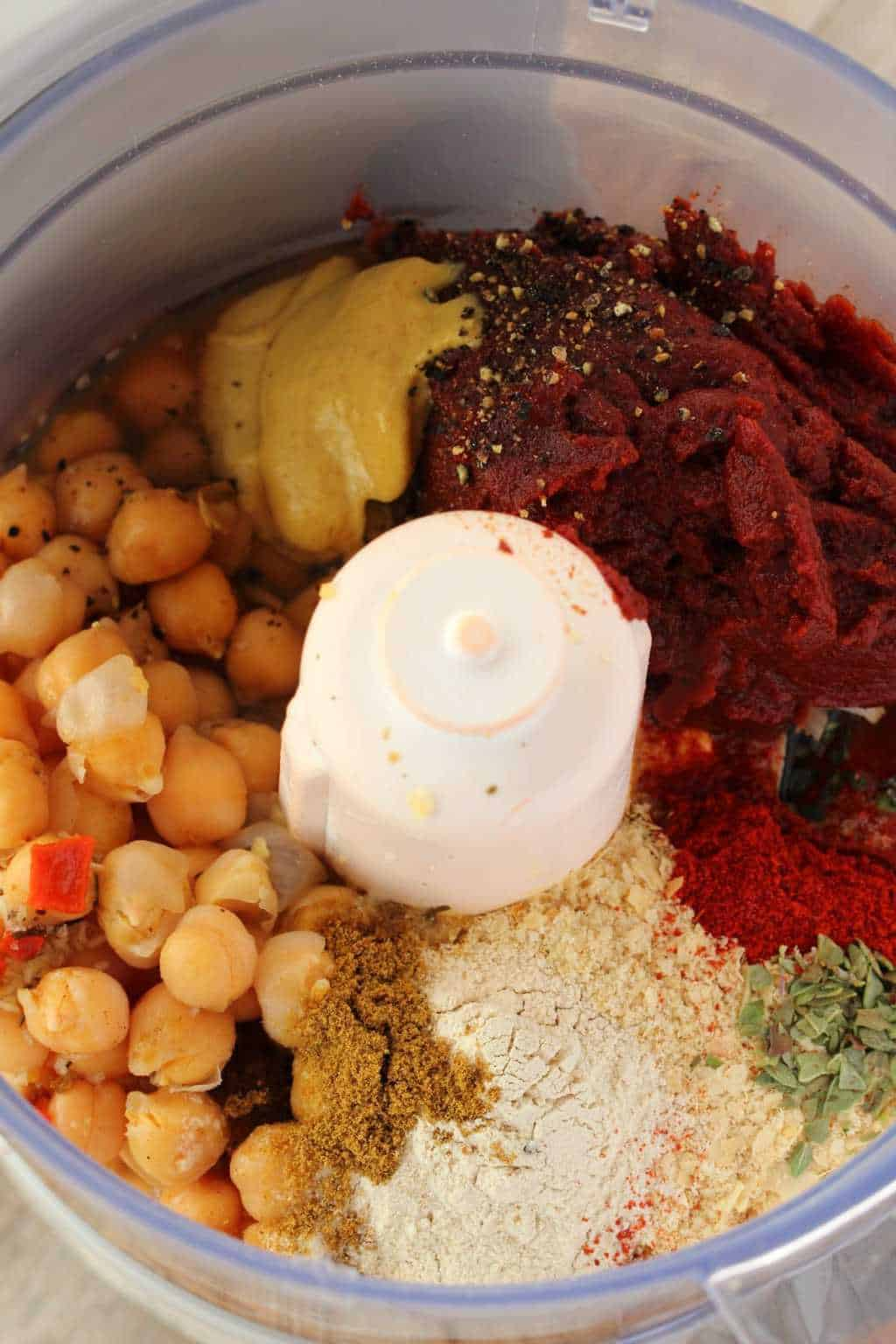 Chickpeas, tomato paste and spices in a food processor