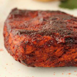 Vegan steak on a white plate.