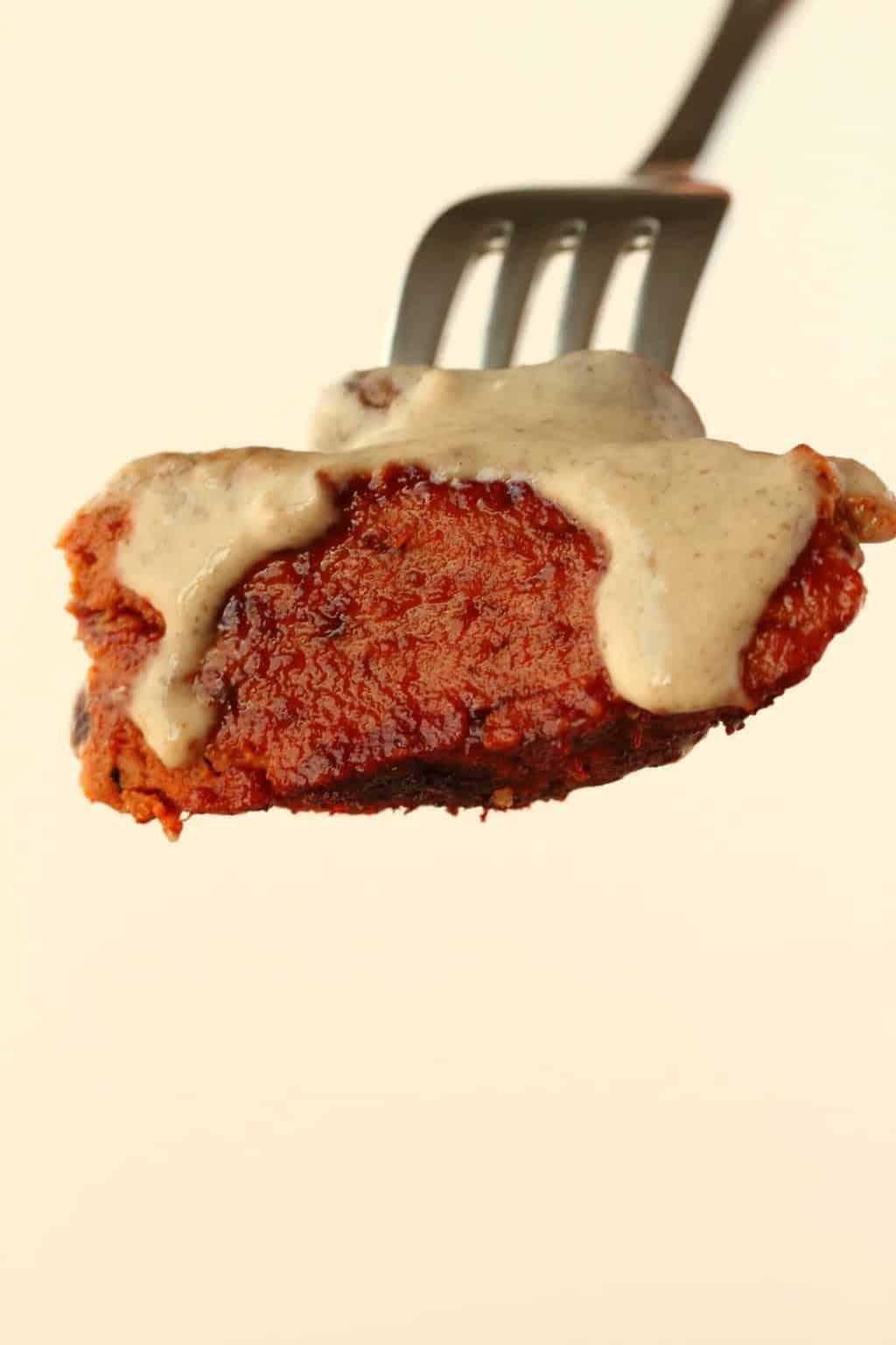 c0e0cf2f664b A forkful of vegan steak covered in mushroom sauce.