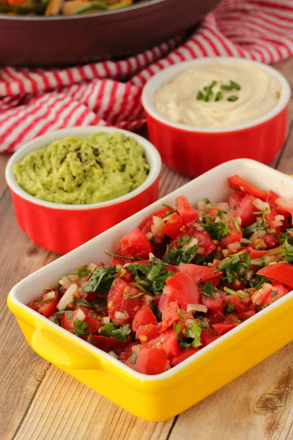 Tomato salsa, guacamole and vegan sour cream for veggie fajitas.