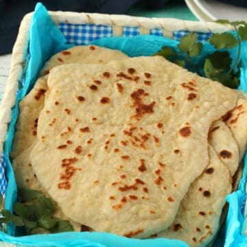 Vegan naan stacked up in a basket