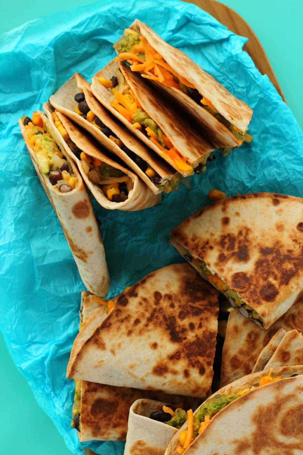 Vegan Quesadillas on blue paper.