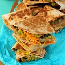 Vegan quesadillas stacked up on top of each other.