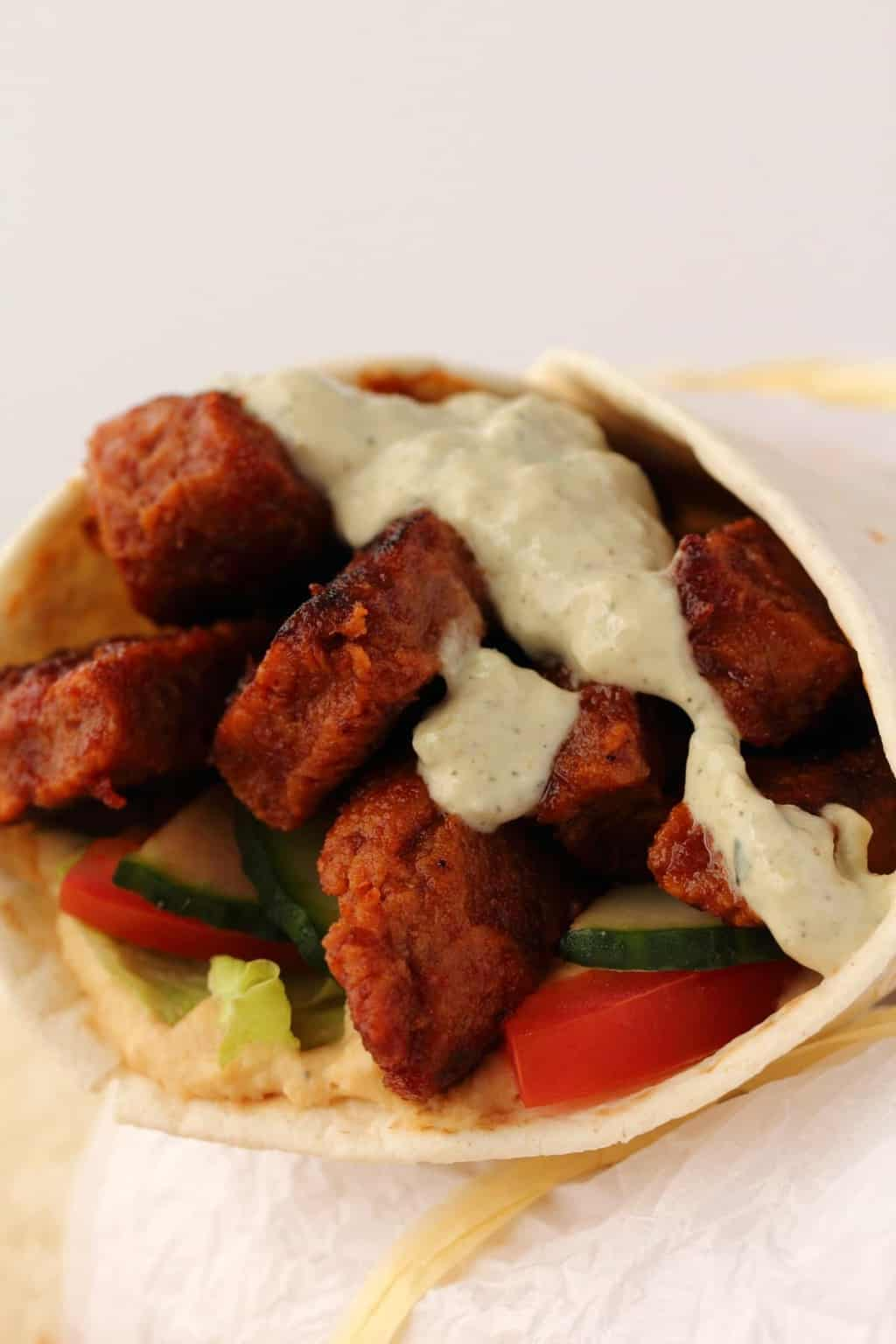 Vegan Shawarma stuffed with seitan and veggies and topped with vegan tzatziki.