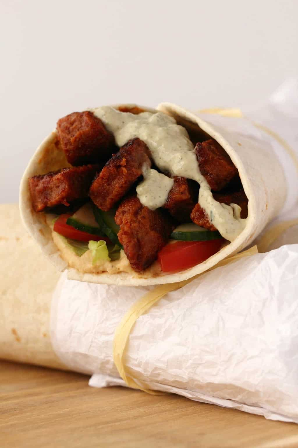 Vegan Shawarma stuffed with seitan and veggies and topped with vegan tzatziki