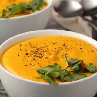 Vegan sweet potato soup in white bowls.