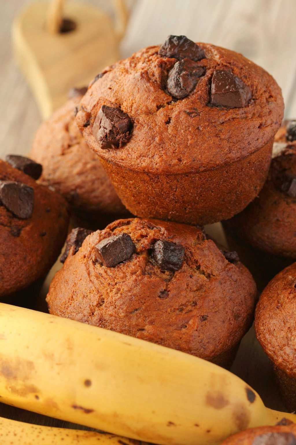Vegan banana chocolate chip muffins in a stack.
