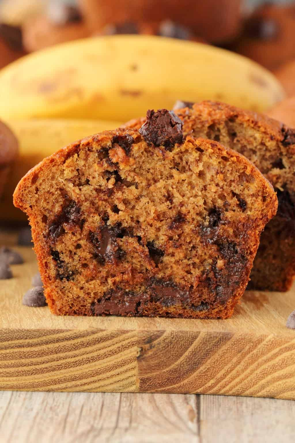 Vegan banana chocolate chip muffin sliced in half to show the center.