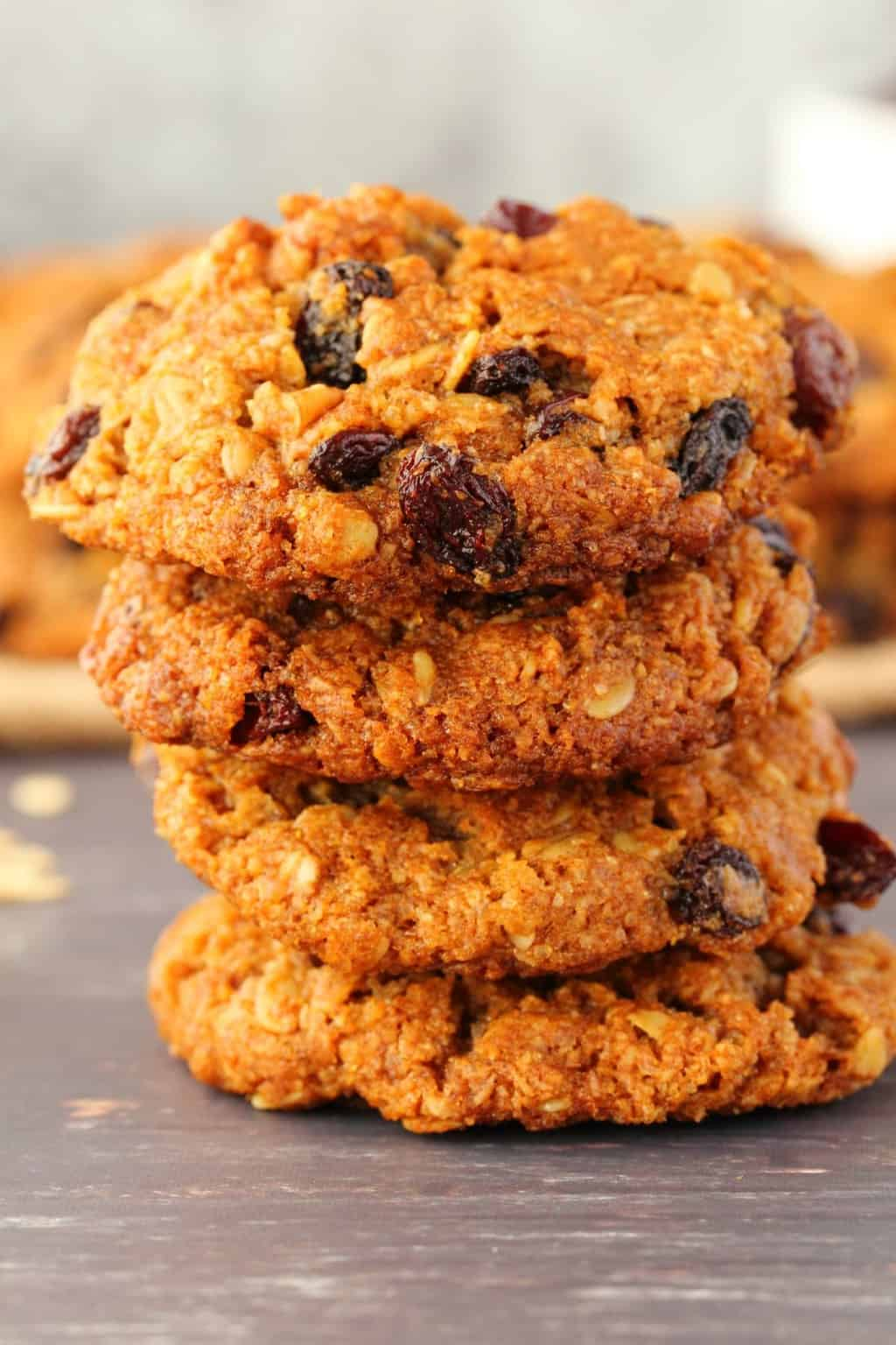 Vegan oatmeal raisin cookies in a stack of four.