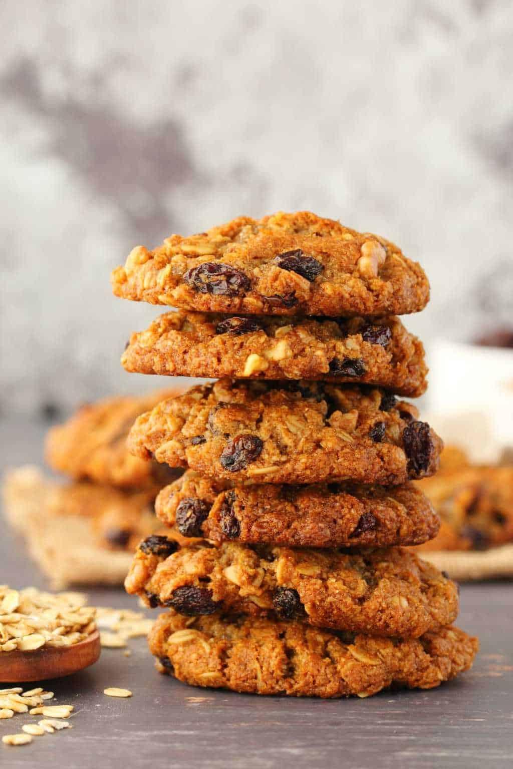 Vegan oatmeal raisin cookies in a stack of six.