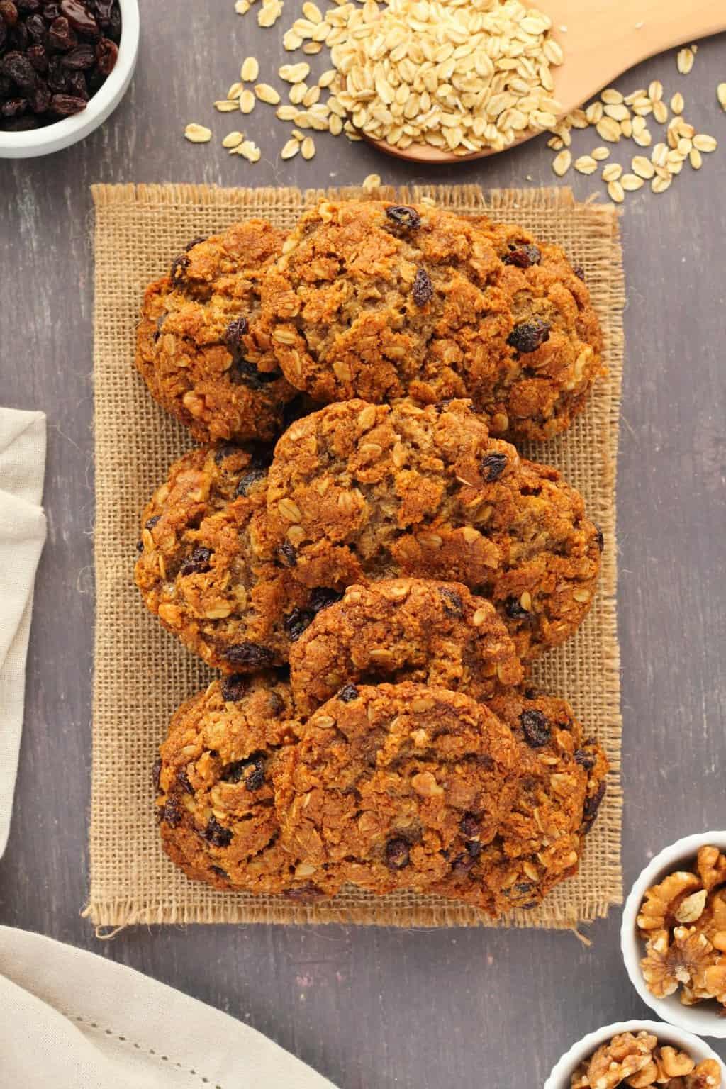Vegan oatmeal raisin cookies on a woven napkin.