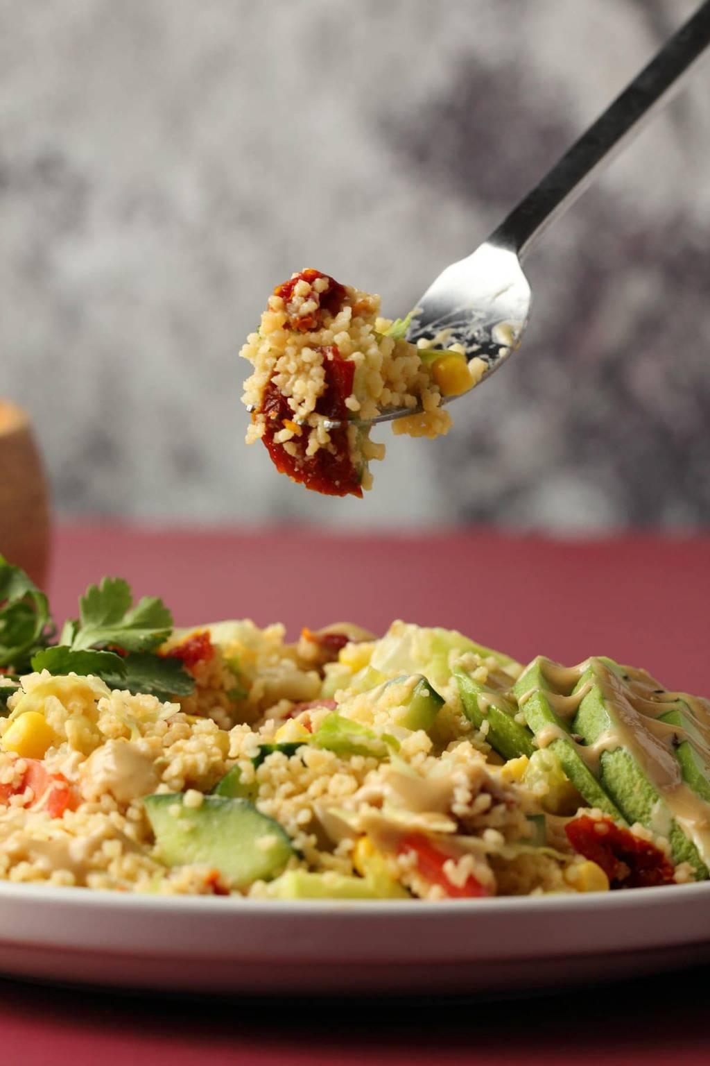 Vegan couscous salad on a white plate.