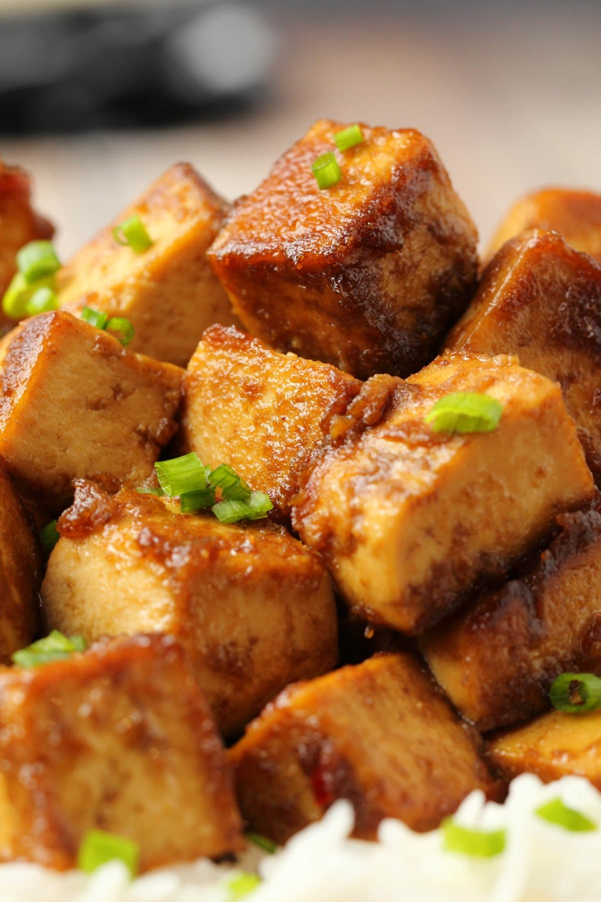 Marinated tofu topped with chopped chives.