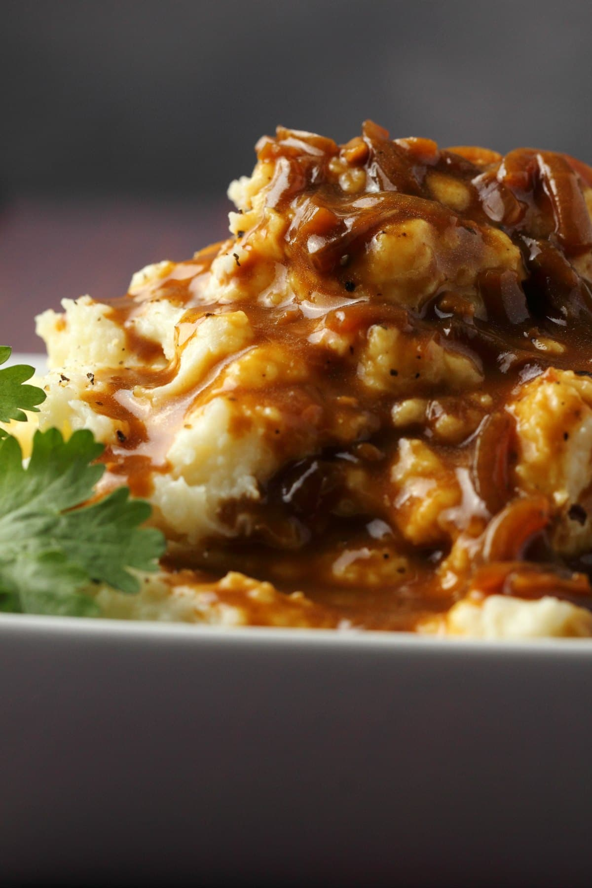 Mashed potatoes covered in gravy.